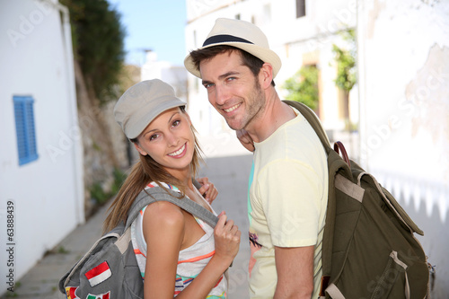 Smiling couple of backpackers enjoying journey