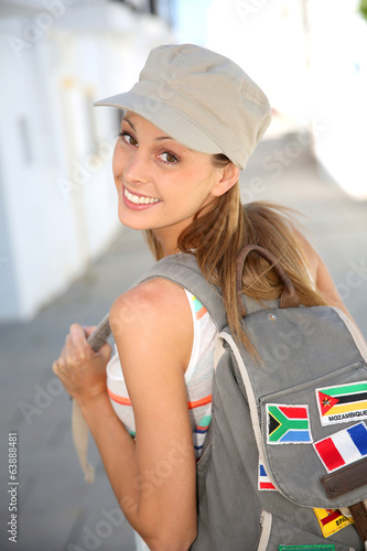 Trendy girl with backpack traveling in Europe