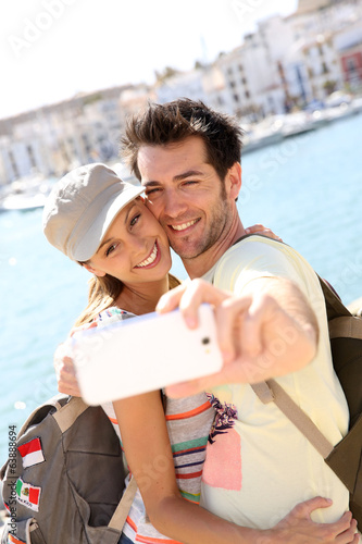 Couple taking picture of themselves during vacation