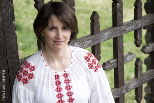 Smiling woman in Ukrainian traditional dress