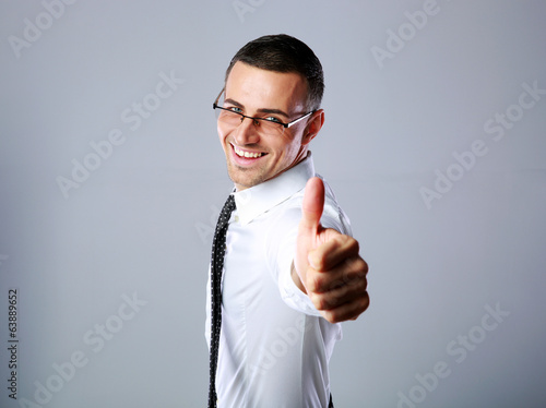 happy businessman showing thumb up