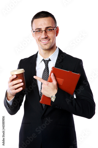 businessman holding cup of coffee and tablet computer