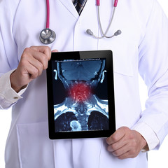 Doctor holding touch pad for Painful neck X-ray
