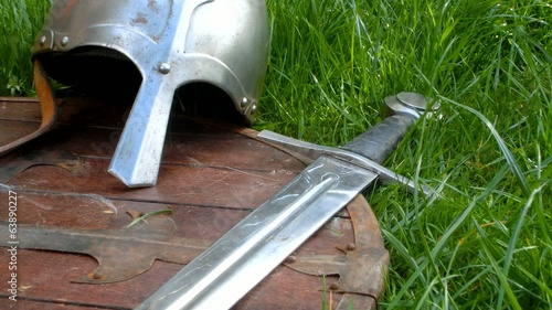 Medieval sword, helmet and shield - close up