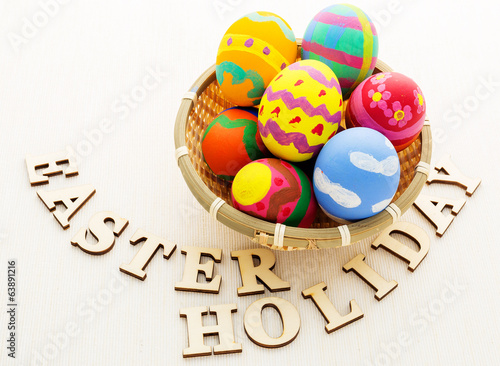 Painted easter egg with wooden text