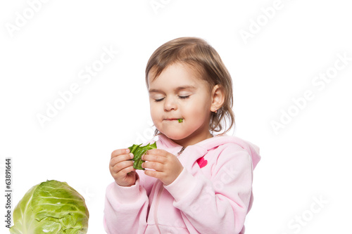 little girl eating cabbage