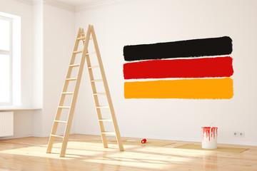Deutschlandfahne an Wand im Raum