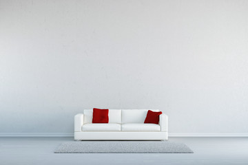 Sofa mit Teppich vor leerer Wand