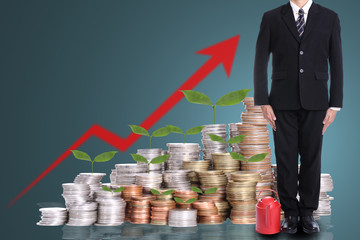 Businessman stand with red watering pot
