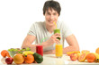 Man having a table full of organic food,juices, smoothie, salad