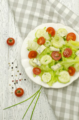 Salad with lettuce, tomatoes and cucumbers