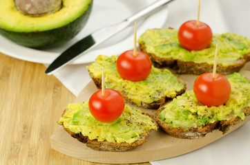 Avocado and tomatoes on seed bread