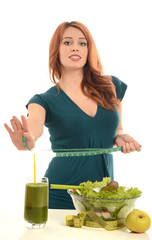 Woman with a centimeter on her waist thinking on dieting