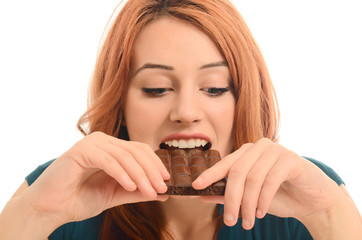 Happy woman eating a yummy chocolate and having some sugar