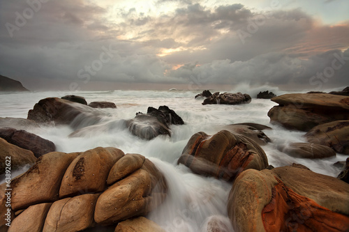 Ocean surges over weathered rocks