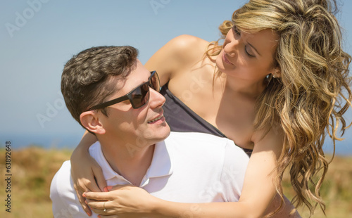 Love couple embracing outdoors on a summer day