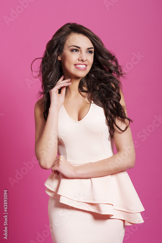Portrait of beautiful woman on pink background