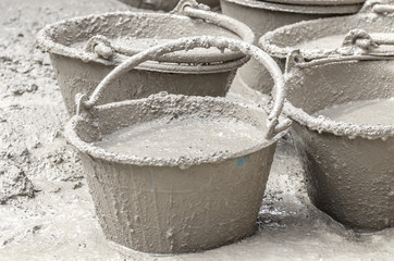 Plastic buckets for transport of cement at construction,