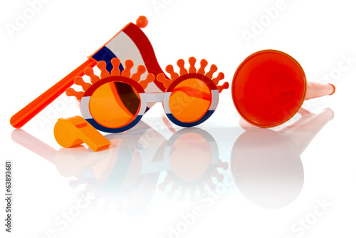 plastic glasses horn flute and flag in orange color