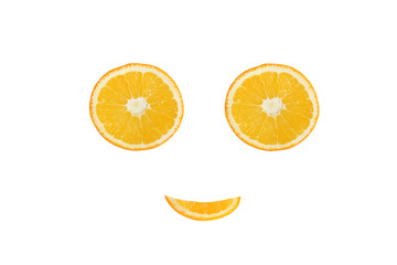 Healthy eating. Funny face made of the orange slices
