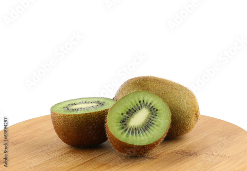 Sliced juicy kiwi fruit on wooden plate