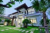 Modern house at night - 63894465