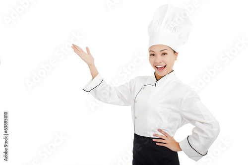 young female cook raise hands to show something