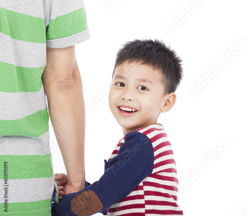 Little boy holding the hand of the father and looking back