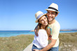 Portrait of sweet couple embracing by the beach