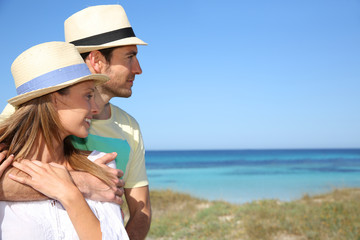Couple of tourists admiring view from Formentera Island