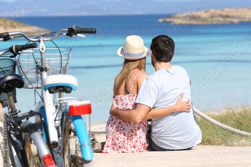 Romantic couple sitting in front of the sea