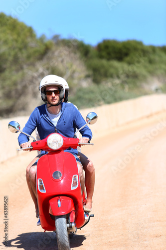 Man riding motorcycle with girlfriend