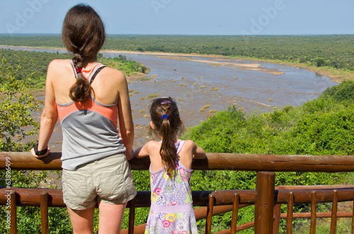 Mother and daughter looking at river, tourists in South Africa