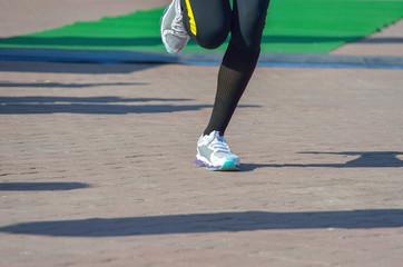Running concept, man's legs run in sport shoes
