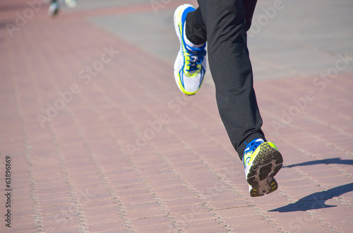 Running concept, man's legs run in sport shoes