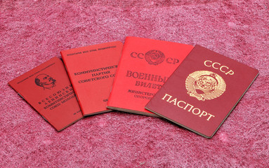 Old Soviet documents on a red background