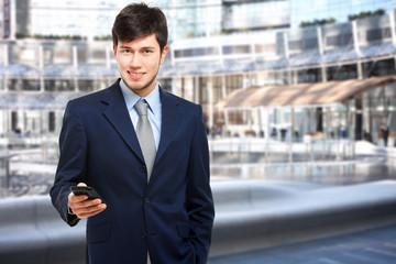 Businessman sending a sms