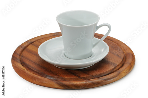 White ceramic coffee cup and white saucer on wooden stand.