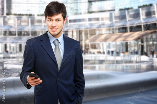Businessman sending a sms