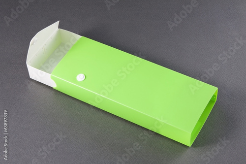 Open Empty Pencil Box on Gray Background.