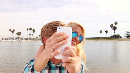 Young Happy Couple Taking Selfie At Beach