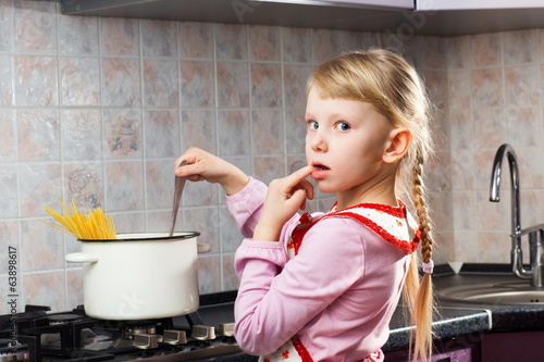 puzzled girl cooking in the kitchen