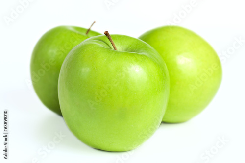 ripe fresh green apples on white background