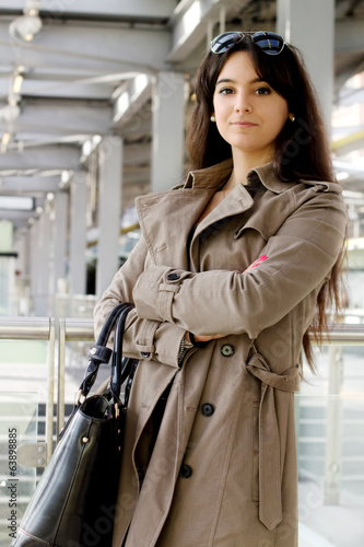 young businesswoman over industrial background