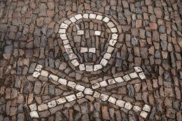 Stone symbol Skull and bones , Touristic place kostnice - Kutna