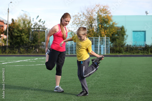 Athletic mother and son engaged in fitness