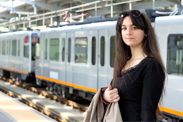 young student against train background