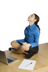 Young business woman doing yoga
