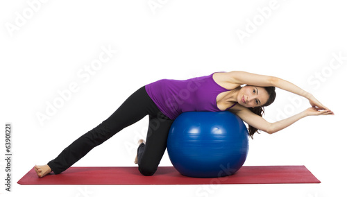 Woman doing pilates exercises for flexibility