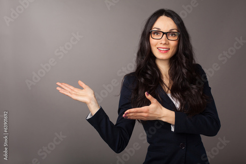 brunette woman presenting copyspace